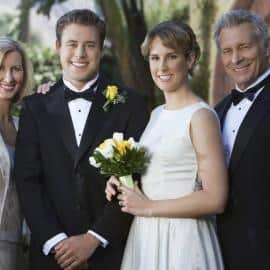 Newly Married Couple Standing With Parents